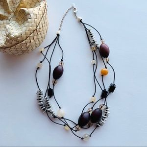Versatile multi-strand mixed media necklace - Mexx